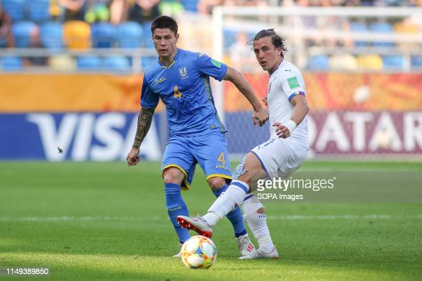 Denys Popov of Ukraine and Luca Pellegrini of Italy are seen in action during the FIFA U-20 World Cup match between Ukraine and Italy in Gdynia. .