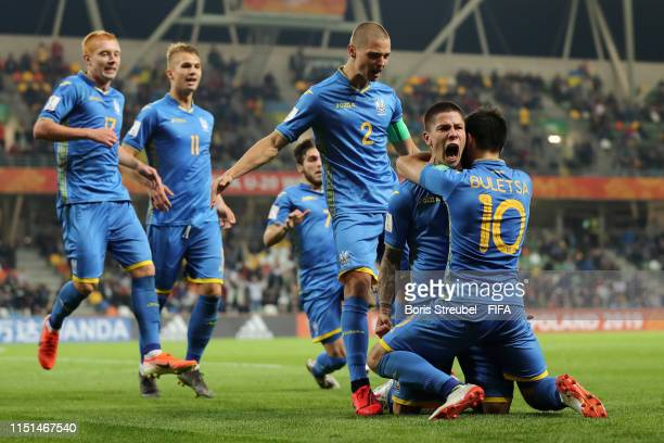 Denys Popov of Ukraine celebrates with team mates after scoring his team's second goal during the 2019 FIFA U20 World Cup group D match between...