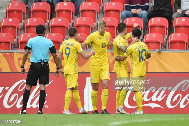 Denys Popov of Ukraine celebrates with teammates after scoring his team's first goal during the 2019 FIFA U20 World Cup group D match between Qatar...