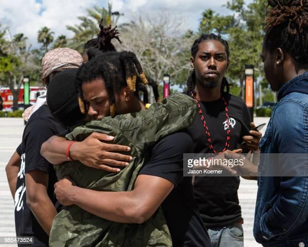 Denzel Curry hugs a friend outside the XXXTentacion Funeral Fan Memorialat BBT Center on June 27 2018 in Sunrise Florida
