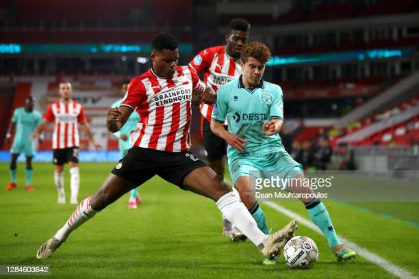 Denzel Dumfries and Ibrahim Sangare of PSV battle for the ball with Mats Kohlert of Willem II during the Dutch Eredivisie match between PSV Eindhoven...