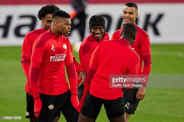 Denzel Dumfries, Noni Madueke, Pablo Rosario and Cody Gakpo joke with Jordan Teze of PSV Eindhoven during training session ahead of the UEFA Europa...