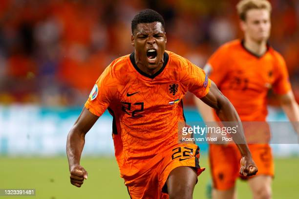 Denzel Dumfries of Netherlands celebrates after scoring their side's third goal during the UEFA Euro 2020 Championship Group C match between...
