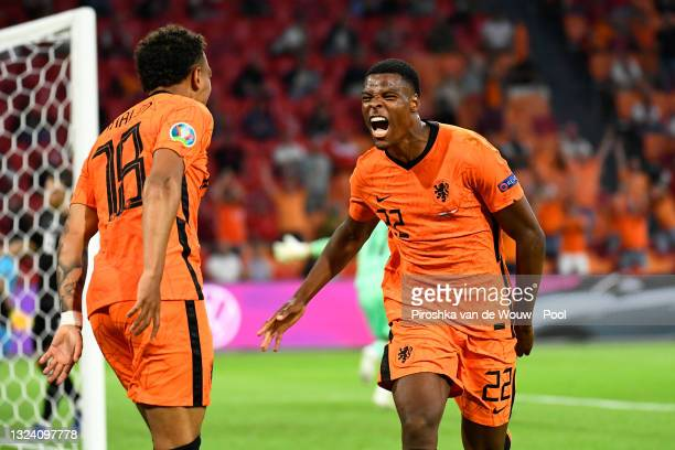Denzel Dumfries of Netherlands celebrates after scoring their side's second goal during the UEFA Euro 2020 Championship Group C match between the...