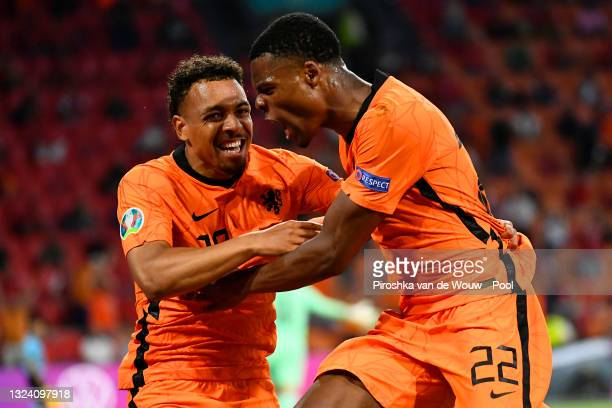 Denzel Dumfries of Netherlands celebrates with Donyell Malen after scoring their side's second goal during the UEFA Euro 2020 Championship Group C...