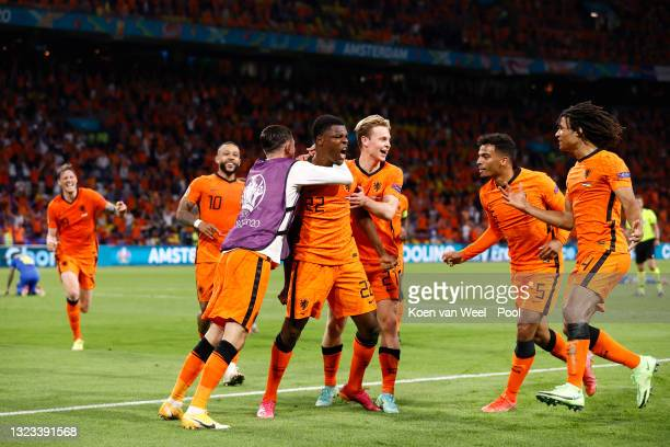 Denzel Dumfries of Netherlands celebrates with Frenkie de Jong and team mates after scoring their side's third goal during the UEFA Euro 2020...