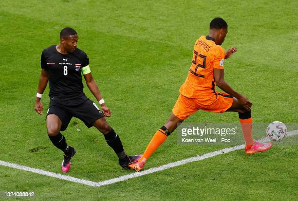 Denzel Dumfries of Netherlands is fouled by David Alaba of Austria leading to a penalty being awarded during the UEFA Euro 2020 Championship Group C...