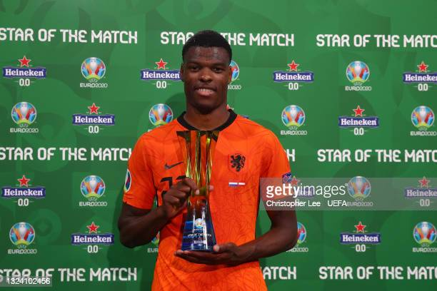 """Denzel Dumfries of Netherlands poses for a photograph with their Heineken """"Star of the Match"""" award after the UEFA Euro 2020 Championship Group C..."""