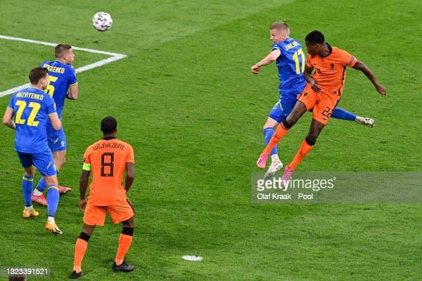 Denzel Dumfries of Netherlands scores their side's third goal whilst under pressure from Oleksandr Zinchenko of Ukraine during the UEFA Euro 2020...