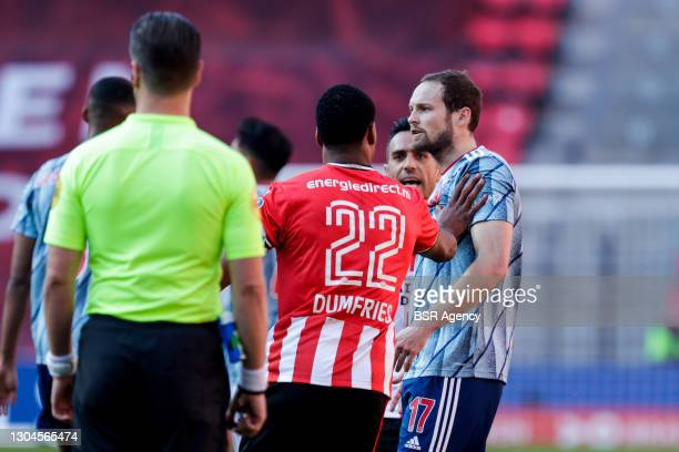 Denzel Dumfries of PSV and Daley Blind of Ajax during the Dutch Eredivisie match between PSV and Ajax at Philips Stadion on February 28, 2021 in...