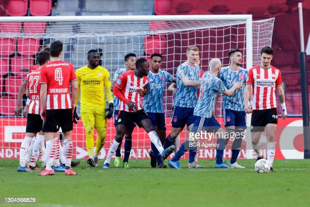 Denzel Dumfries of PSV and Dusan Tadic of Ajax during the Dutch Eredivisie match between PSV and Ajax at Philips Stadion on February 28, 2021 in...
