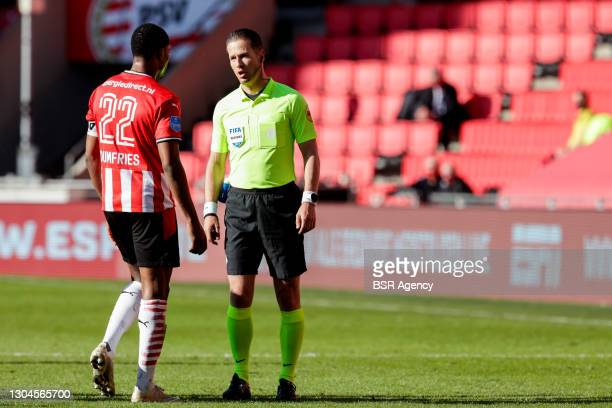 Denzel Dumfries of PSV and referee Danny Makkelie during the Dutch Eredivisie match between PSV and Ajax at Philips Stadion on February 28, 2021 in...