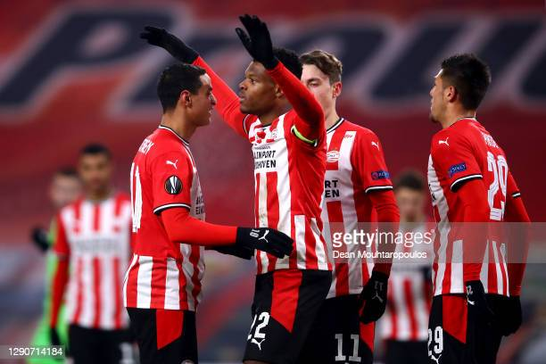 Denzel Dumfries of PSV celebrates scoring his teams second goal of the game from the penalty spot with team mates during the UEFA Europa League Group...