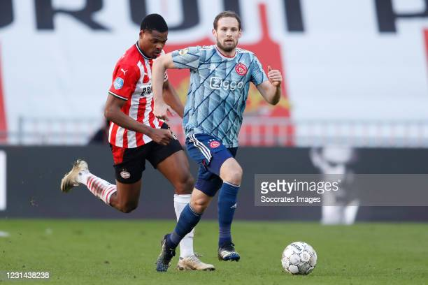Denzel Dumfries of PSV, Daley Blind of Ajax during the Dutch Eredivisie match between PSV v Ajax at the Philips Stadium on February 28, 2021 in...