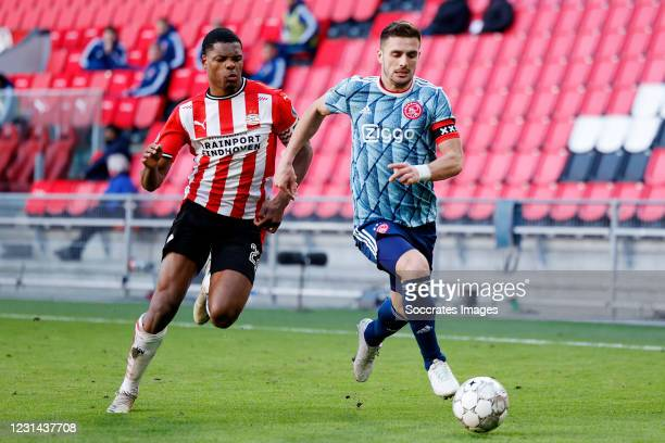 Denzel Dumfries of PSV, Dusan Tadic of Ajax during the Dutch Eredivisie match between PSV v Ajax at the Philips Stadium on February 28, 2021 in...