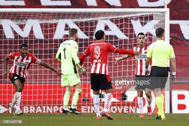Denzel Dumfries of PSV Eindhoven, Ajax goalkeeper Maarten Stekelenburg, Donyell Malen of PSV Eindhoven, Eran Zahavi or PSV Eindhoven, referee Danny...