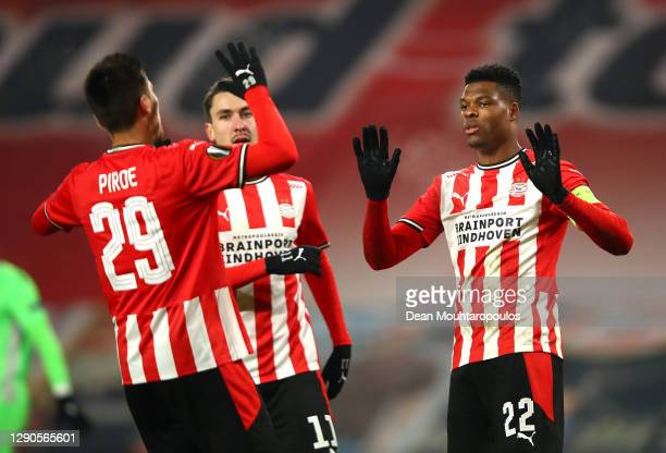 Denzel Dumfries of PSV Eindhoven celebrates after scores their team's first goal from the penalty spot with Joel Piroe of PSV Eindhoven and Adrian...
