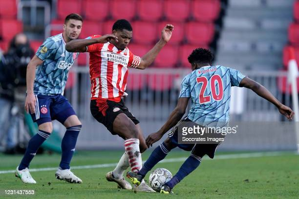 Denzel Dumfries of PSV, Mohammed Kudus of Ajax during the Dutch Eredivisie match between PSV v Ajax at the Philips Stadium on February 28, 2021 in...
