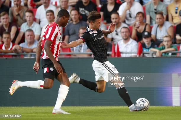 , Denzel Dumfries of PSV, Valentin Stocker of FC Basel during the UEFA Champions League second round qualifying first leg match between PSV Eindhoven...