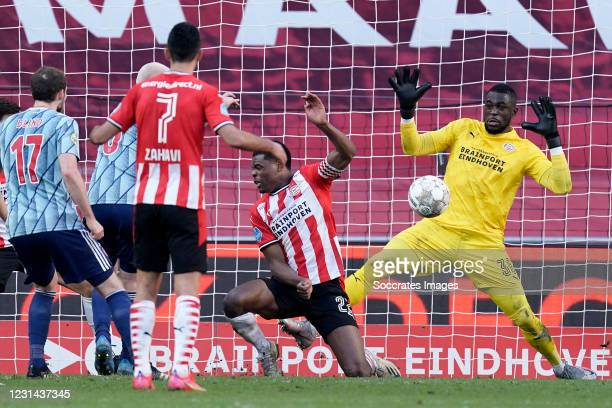 Denzel Dumfries of PSV, Yvon Mvogo of PSV during the Dutch Eredivisie match between PSV v Ajax at the Philips Stadium on February 28, 2021 in...