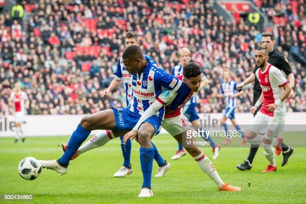 Denzel Dumfries of sc Heerenveen Justin Kluivert of Ajax during the Dutch Eredivisie match between Ajax Amsterdam and sc Heerenveen at the Amsterdam...
