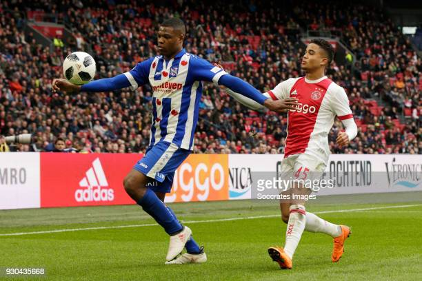 Denzel Dumfries of SC Heerenveen Justin Kluivert of Ajax during the Dutch Eredivisie match between Ajax v SC Heerenveen at the Johan Cruijff Arena on...
