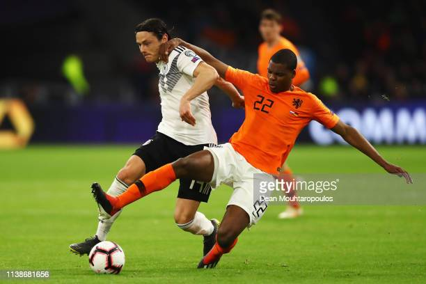 Denzel Dumfries of the Netherlands battles for the ball with Nico Schulz of Germany during the 2020 UEFA European Championships group C qualifying...