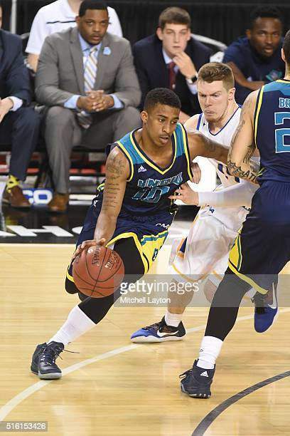 Denzel Ingram of the North CarolinaWilmington Seahawks dribbles the ball during the Colonial Athletic Conference Championship college basketball game...