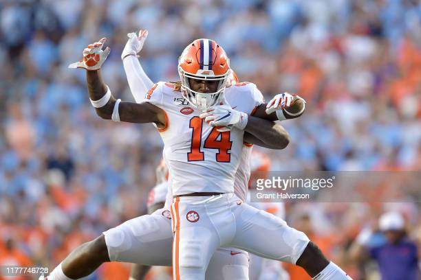 Denzel Johnson and Nyles Pinckney of the Clemson Tigers celebrate after stopping a twopoint conversion attempt by the North Carolina Tar Heels during...