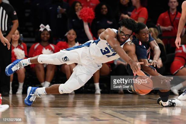 Denzel Mahoney of the Creighton Bluejays battles Greg Williams Jr. #4 of the St. John's Red Storm for a loose ball in the first half during the...
