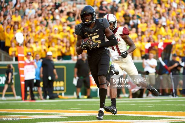 Denzel Mims of the Baylor Bears breaks free for a 15 yard touchdown reception against the Baylor Bears during the first half at McLane Stadium on...