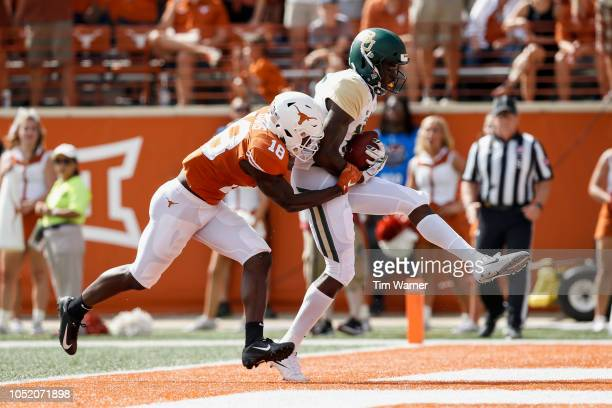 Denzel Mims of the Baylor Bears catches a pass for a touchdown defended by Davante Davis of the Texas Longhorns in the first half of the Baylor Bears...