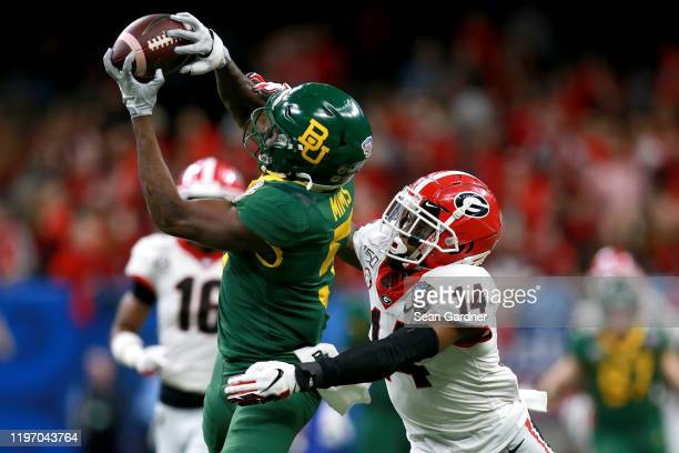 Denzel Mims of the Baylor Bears catches a pass over DJ Daniel of the Georgia Bulldogs during the Allstate Sugar Bowl at Mercedes Benz Superdome on...