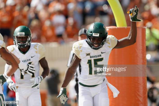Denzel Mims of the Baylor Bears celebrates after a touchdown reception in the first half against the Texas Longhorns of the Baylor Bears at Darrell K...