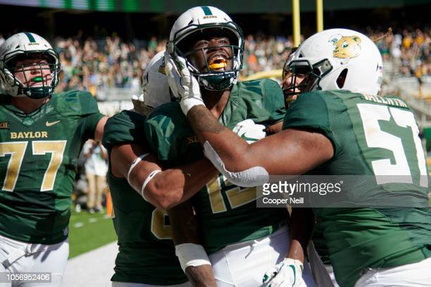 Denzel Mims of the Baylor Bears celebrates with his teammates after scoring the game winning touchdown on a 6 yard reception against the Oklahoma...