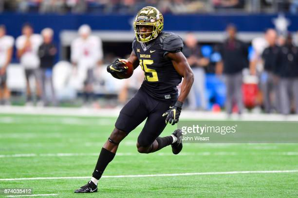 Denzel Mims of the Baylor Bears finds open running room during the game against the Texas Tech Red Raiders on November 11 2017 at ATT Stadium in...