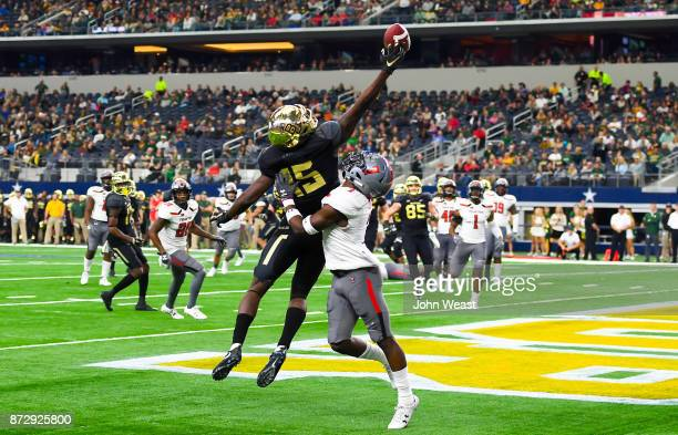 Denzel Mims of the Baylor Bears is unable to make the one handed catch while being defended by Jah'Shawn Johnson of the Texas Tech Red Raiders during...