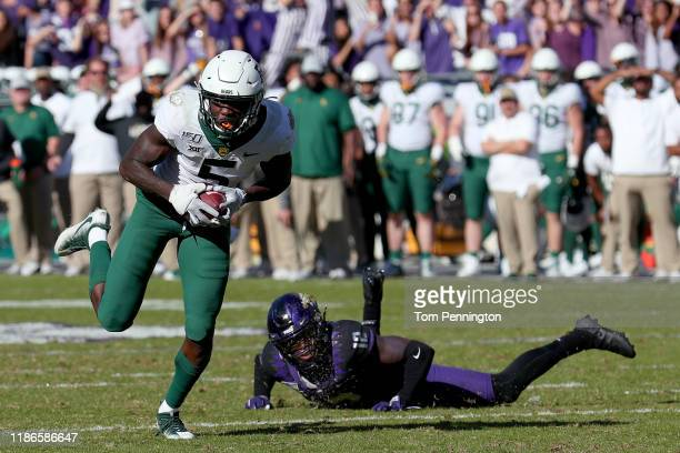 Denzel Mims of the Baylor Bears scores a touchdown against Jeff Gladney of the TCU Horned Frogs in the second overtime period at Amon G Carter...