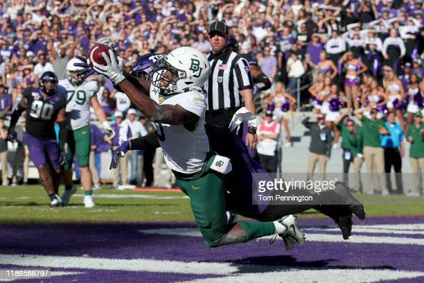 Denzel Mims of the Baylor Bears tries to hang on to the ball on a twopoint attempt against the TCU Horned Frogs in the third overtime period at Amon...