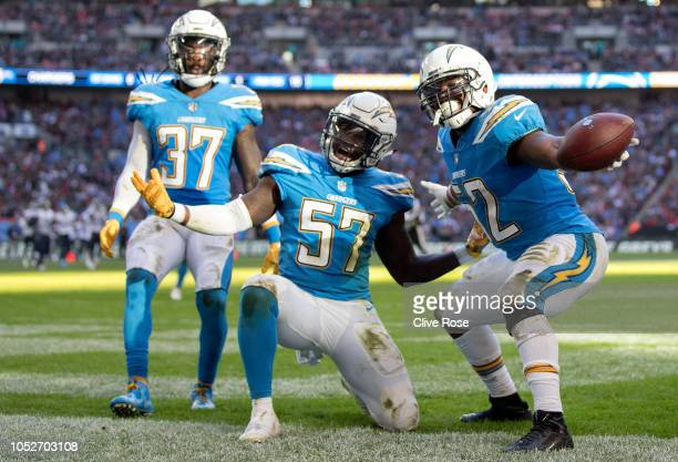 Denzel Perryman of Los Angeles Chargers and team mates celebrate his interception during the NFL International Series match between Tennessee Titans...