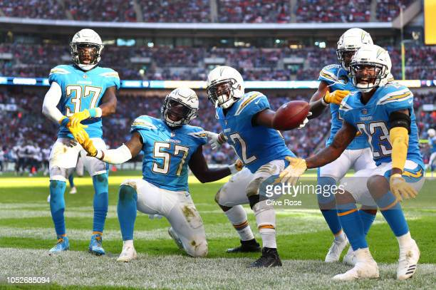 Denzel Perryman of Los Angeles Chargers celebrates his interseption with teammates during the NFL International Series match between Tennessee Titans...