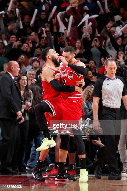 Denzel Valentine and Zach LaVine of the Chicago Bulls celebrate after the game against the LA Clippers on December 14 2019 at United Center in...