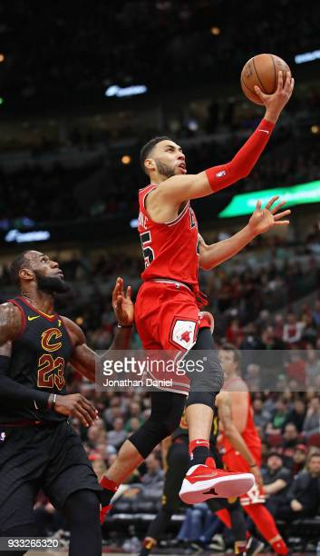 Denzel Valentine of the Chicago Bulls drives past LeBron James of the Cleveland Cavaliers on his way to a gamehigh 34 points at the United Center on...