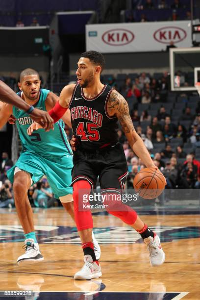 Denzel Valentine of the Chicago Bulls handles the ball against the Charlotte Hornets on December 8 2017 at Spectrum Center in Charlotte North...