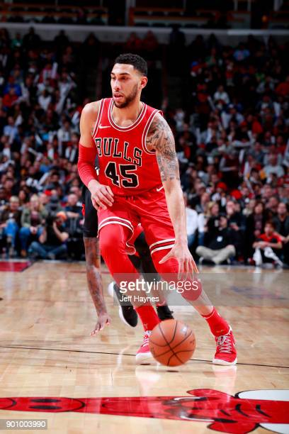 Denzel Valentine of the Chicago Bulls handles the ball during the game against the Toronto Raptors on January 3 2018 at the United Center in Chicago...