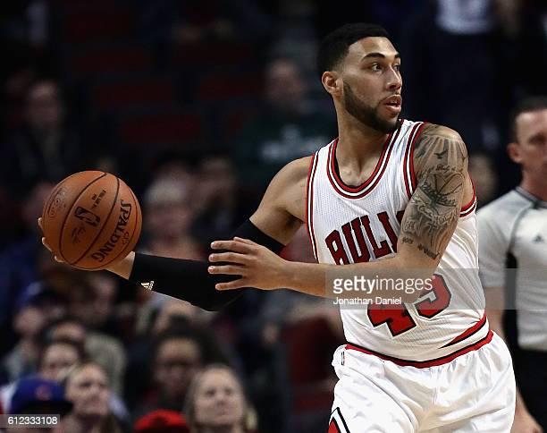 Denzel Valentine of the Chicago Bulls looks to pass against the Milwaukee Bucks during a preseason game at the United Center on October 3 2016 in...
