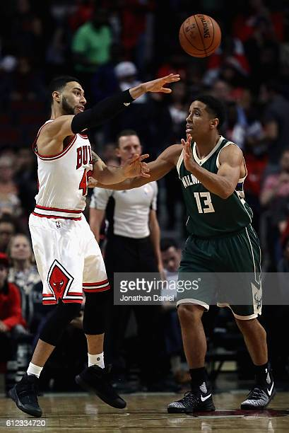 Denzel Valentine of the Chicago Bulls passes around Malcolm Brogdon of the Milwaukee Bucks during a preseason game at the United Center on October 3...