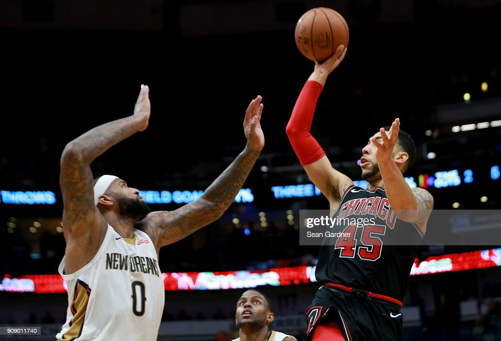 Denzel Valentine Of The Chicago Bulls Shoots Over DeMarcus Cousins Of The  New Orleans Pelicans During