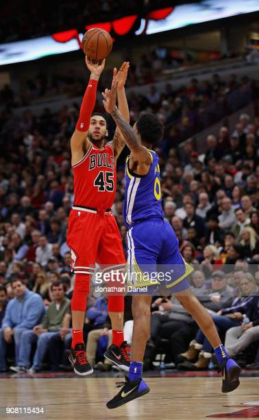 Denzel Valentine of the Chicago Bulls shoots over Patrick McCaw of the Golden State Warriors at the United Center on January 17 2018 in Chicago...