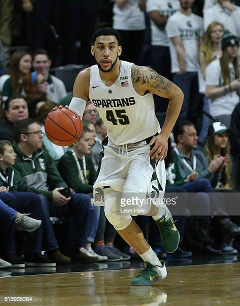 Denzel Valentine of the Michigan State Spartans brings the ball down the court during the first half of the game against the Ohio State Buckeyes on...